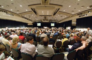 People sit in a large ballroom at the Coeur d'Alene Art Auction.