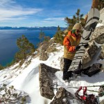 Curtis Woodman clicks together his splitboard for a backcountry run on Tahoe's East Shore, photo by Seth Lightcap.